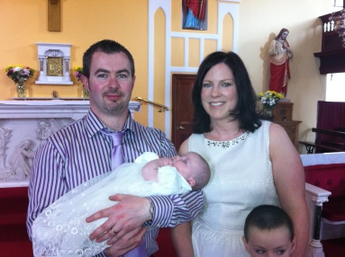 Carmel and Michael with Aoife on her baptism day.