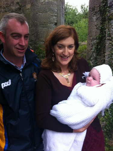 Seán Óg Patrick Cleary with his parents Lorraine and Michael on his baptism day on Canons' Island.