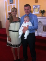Rian John on his baptism day with his parents Cheryl and Clinton