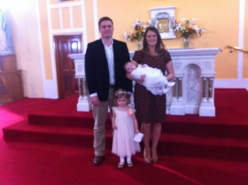 Cara with her parents and sister on her baptism day.