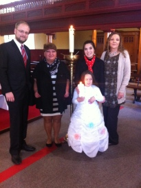 Aleksandra on her baptism day with her mother Dialena, her grandmother Irina and her godparents Thelma Murray and Christian Riere.