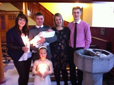 Amelie and Kalia with their parents and godparents on their baptism day.