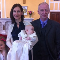 Anna with her parents on her baptism day.