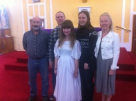 Taylem with her parents and godparents on her baptism day.