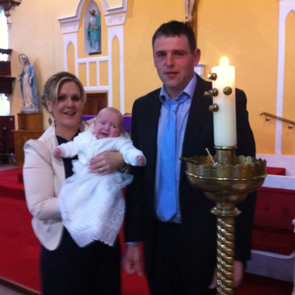 Alex and his parents on his baptism day.