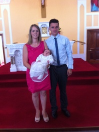 Evan Joseph Connelly with his parents on his baptism day.