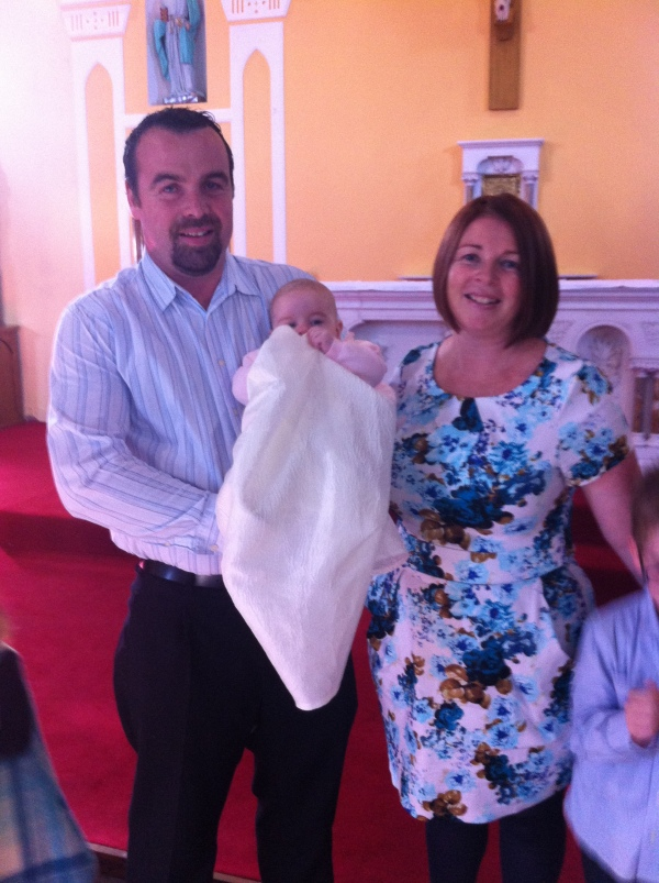 Layla Faith with her parents on her baptism day.