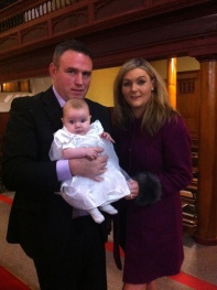 Sophie Mae with her parents on her baptism day.