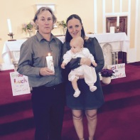 Joshua-Robin Creaven with his parents on his baptism day.
