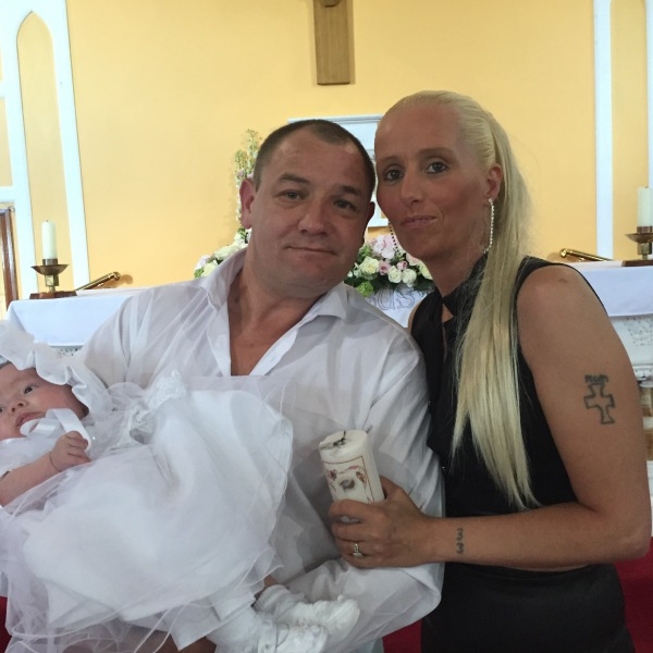 Dacota Dallas Purcell with her parents Mary and Keith on her baptism day.