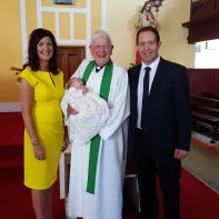 Patrick Michael Thomas Casey with his parents and Fr Michael O'Grady on his baptism day.