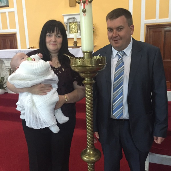 Naoimi Amy Clancy with her parents Mary and Thomas on her baptism day 10 October, 2015