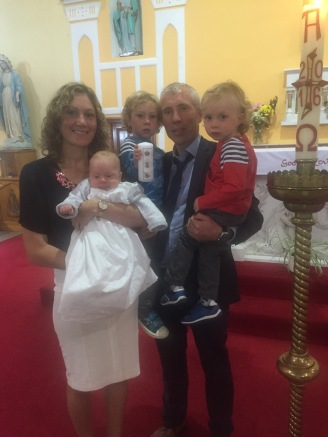 Tadgh Seamus Power with his parents Eimear and Seamus and his brothers Liam and Oisin on his baptism day.
