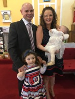 Emma Mary Saoirse Flynn with her parents Caitriona and Derek and sister Katie on her baptism day.