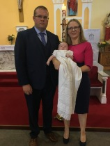 Saoirse Rose O'Connell on her baptism day with her parents Niamh and Owen.