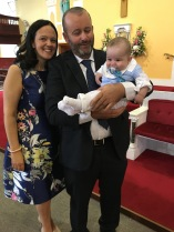 Rory Brian O Malley with his parents Angela and Martin on his baptism day.