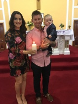Caey Thomas Fox on his baptism day with his parents Sinéad and Dylan, Main Street.