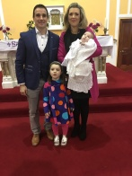 Luke Daniel O'Grady on his baptism day with his parents Éimear and Noel and his sister Leah.