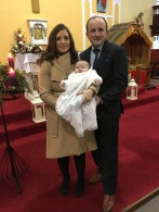 Darragh Eustace on his baptism day with his parents Martina and Brian.