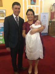 Elsie Rose Garry with her parents, Yvonne and Michael on her baptism day.