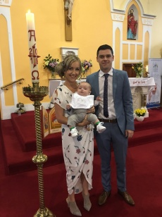 Arthur Daniel Field with his parents on his baptism day.