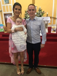 Amelia Kate Elizabeth Clancy with her parents Edel and Brian on her baptism day.