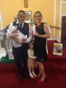 Amy Kate O'Sullivan with her parents Brendan snd Mary and sister Sophie on her baptism day.