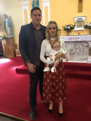 Rían Joseph Casey with ihs parents, Aisling and Niall on his baptism day.