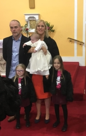 Ella Doohan with her parents and sisters on her baptism day.
